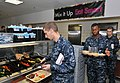 U.S. Navy recruits receive food inside the USS Triton recruit barracks' galley at Recruit Training Command at Naval Station Great Lakes, Ill 121031-N-IK959-270.jpg