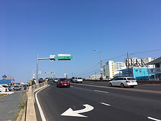 Westbound view on US 50 (Ocean Gateway) leaving Ocean City. Sign over eastbound lane displays distance to Sacramento, California as 3,073 miles US 50 WB past MD 528.jpeg