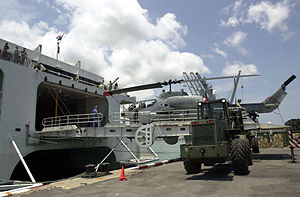 MV Westpac Express (HSV-4676) - MV Westpac Express (HSV-4676) offloads cargo at Chuk Samet, Sattahip, Thailand on 8 May 2002. An AH-1W Super Cobra attack helicopter from Marine Light Attack Helicopter Squadron 369 HMLA-369 is being moved across the stern ramp.