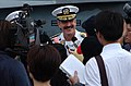 US Navy 030807-N-3241H-029 Rear Adm. Marty Chanik, Commander Carrier Group Three, answers questions from local Hong Kong media during a press conference held on the flight deck aboard Carl Vinson.jpg