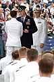 US Navy 040528-N-2383B-165 A newly commissioned Ensign receives his diploma from the Chairman of the Joint Chiefs of Staff, Gen. Richard B. Meyers.jpg