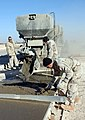 US Navy 041201-M-0484L-006 U.S. Navy Seabees assigned to Naval Mobile Construction Battalion Two Three (NMCB-23), pour mixed concrete during repairs to the south runway at Al Asad Airport, Iraq.jpg
