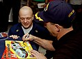 US Navy 041207-N-2984R-058 NASCAR Nextel Cup driver John Andretti signs autographs for Chief Hospital Corpsman Michael Zurek on the mess decks of the Nimitz-class aircraft carrier USS Harry S. Truman (CVN 75).jpg