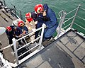 US Navy 050228-N-9563N-005 Members of Naval Support Activity (NSA) Bahrain's Emergency Response Team (ERT) carries a simulated casualty to a designated medical area from the mine countermeasure ship USS Cardinal (MHC 60) durin.jpg