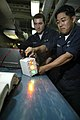 US Navy 050809-N-3136P-005 Aviation Electrician's Mate 3rd Class David Sumida, right, conducts a quality check on an F-A-18 Super Hornet angle of attack indicator.jpg