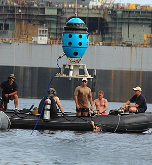 Cerberus (sonar) - U.S. Navy sailors guiding a Cerberus Swimmer Detection System into the water at Naval Station Pascagoula.