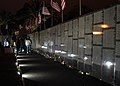 US Navy 060506-N-7217H-005 The three-quarters Dignity Memorial Vietnam Wall, which stands at 240-feet long and 8-feet high is illuminated by the night-lights.jpg