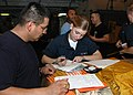 US Navy 070523-N-0998G-048 Damage Controlman Fireman Cierra M. Dodd, a native of Wilmington, Ohio, verifies mailing tags while Chief Postal Clerk Tony Zarate supervises prior to mail departing the ship.jpg