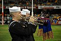 US Navy 070630-N-1113S-003 Musician 1st Class Jason Gromacki displays the colors of the home team while playing at the Gabba, a major stadium in Brisbane.jpg
