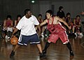 US Navy 070702-N-4649C-090 Storekeeper 2nd Class David Clark, a Sailor stationed aboard guided-missile destroyer USS John S. McCain (DDG 56), participates in a basketball game.jpg