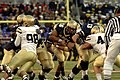 US Navy 071201-N-0989H-674 Fullback for the U.S. Naval academy, Midshipman Eric Kettani, finds a hole in the Black Knights defense.jpg