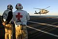 US Navy 071215-N-3659B-019 Medical personnel aboard the aircraft carrier USS Ronald Reagan (CVN 76) wait to unload a patient from an HH-60H Seahawk.jpg