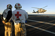 US Navy 071215-N-3659B-019 Medical personnel aboard the aircraft carrier USS Ronald Reagan (CVN 76) wait to unload a patient from an HH-60H Seahawk