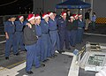 US Navy 071219-N-4658L-020 Sailors assigned to the guided-missile frigate USS Curtis (FFG 38) sing Christmas carols during the 2007 holiday ship decoration contest.jpg