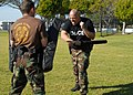 US Navy 080116-N-8607R-111 Department of Defense police and active duty and reserve service members fight each other during an obstacle course that tests how well they can defend themselves with impaired vision.jpg