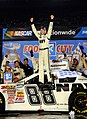US Navy 080822-N-5345W-213 R Motorsports driver Brad Keselowski celebrates on top of the No. 88 U.S. Navy Chevrolet Monte Carlo.jpg