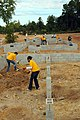 US Navy 080922-N-2539L-020 Sailors level four home sites at a Habitat for Humanity project site.jpg