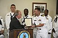 US Navy 080923-N-3271W-031 Cmdr. Joe Klein, commanding officer of Navy Recruiting Command, Raleigh, is presented with a Columbia Navy Week proclamation from Mayor Bob Coble.jpg