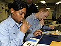 US Navy 090208-N-9187B-005 Air Traffic Controller 2nd Class Jerelyn Alvis, left, and Air Traffic Controller 2nd Class Richard Morton swab for DNA samples during a bone marrow drive aboard the aircraft carrier USS Theodore Roos.jpg