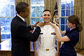 US Navy 090623-N-0000G-001 U.S. President Barack Obama puts on Navy Ensign shoulder boards during Ghanbari's commissioning ceremony in the White House Oval Office.jpg