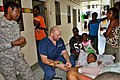 US Navy 100216-F-4646B-003 A U.S. special operations interpreter helps Terry Letsinger check on a Haitian woman who fractured her arm during the 7.0 magnitude earthquake in Port-au-Prince.jpg