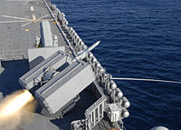 US Navy 100220-N-1524B-057 The amphibious assault ship USS Makin Island (LHD 8) launches a NATO Sea Sparrow missile from the forward NATO mount