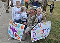 US Navy 100331-N-0710S-006 Builder 2nd Class Jason Shurtz, assigned to Naval Mobile Construction Battalion 74, is welcomed home by his two daughters and son.jpg
