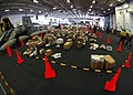 US Navy 100809-N-7103C-004 More than 30,000 pounds of mail is arranged for sorting in the hangar bay of the aircraft carrier USS George Washington (CVN 73) after an extended delay in the delivery of parcels while in South Korea.jpg