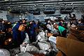 US Navy 110811-N-XE109-735 Sailors sort mail in the hangar bay aboard the aircraft carrier USS George H.W. Bush (CVN 77).jpg