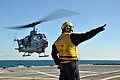 US Navy 111130-N-YX169-130 A helicopter departs the ship.jpg