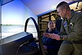 US Navy 120120-D-BW835-003 Secretary of Defense Leon E. Panetta is shown the Joint Strike Fighter Manned Flight Simulator.jpg