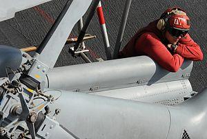 US Navy 120216-N-VO377-182 An aviation ordnanceman rests on the flight deck of the Nimitz-class aircraft carrier USS Abraham Lincoln (CVN 72).jpg