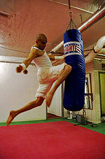 Umar Khan performing a flying knee