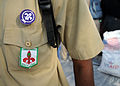 Uniform patches are displayed on a boy scout with the Association Nationale des Scouts d'Haiti while he is providing relief at the soccer stadium in Port-au-Prince, Haiti 100216-N-HX866-005.jpg