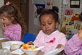 United States children eating at day care.jpg