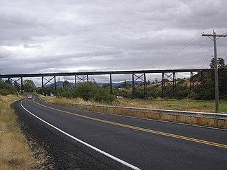 Washington State Route 27 - SR 27 southbound traveling into Tekoa under a trestle bridge carrying the John Wayne Pioneer Trail