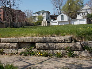 Warner Apartment Building - The stone retaining wall along the sidewalk where the building used to be.