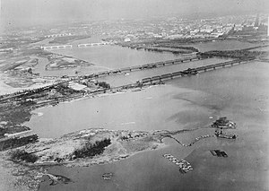 Washington-Hoover Airport - Gravelly Point in 1930, with a dredging ship. The runways of Washington-Hoover can be seen in the middle left of the photograph.