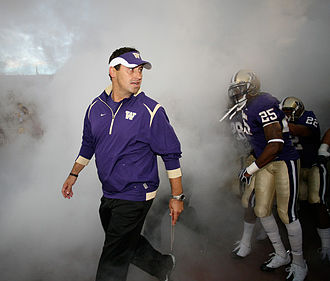 Steve Sarkisian - Sarkisian leading the Huskies onto the field