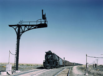 "Railway semaphore signal - Upper quadrant signal on the Santa Fe Railroad, 1943. The vertical position indicates a ""clear"" aspect."