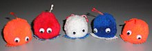 Five weepul toys in various colors