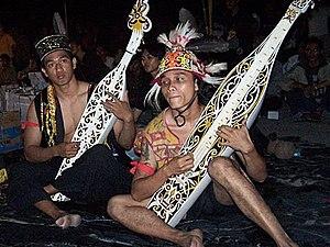 Music of Malaysia - Two Dayak tribemen playing Sapeh in Sarawak