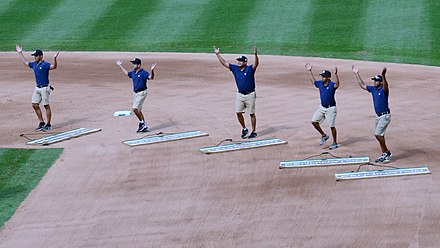 "The grounds crew at Yankee Stadium dancing to ""Y.M.C.A."" Yankee Stadium Grounds Crew Performing YMCA on 8-14-16.jpeg"
