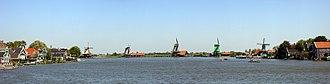 """Zaanse Schans - Names of the mills from left to right: Het Jonge Schaap (""""The Young Sheep""""), De Zoeker (""""The Seeker""""), De Kat (""""The Cat""""), De Gekroonde Poelenburg (""""The Crowned Poelenburg"""") and De Huisman (""""The Houseman"""")."""