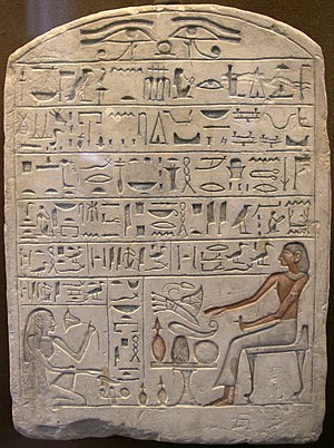 Ancient Egyptian offering formula - The offering formula shown on a funerary stela. On this particular stela, the formula begins on the first line and reads from right to left