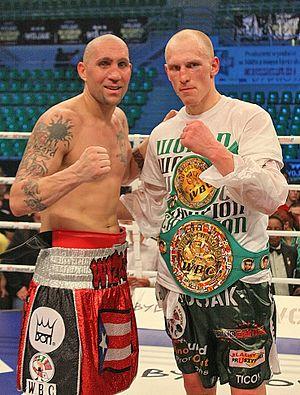Krzysztof Włodarczyk - Włodarczyk and Francisco Palacios after their fight in 2011. Włodarczyk is posing with the WBC title.