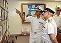 130421-N-IT566-035 Adm. Cecil D. Haney, commander of U.S. Pacific Fleet, points out photos to Vice Adm. Paul Maddison.jpg