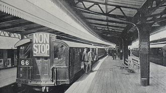London Underground 1906 Stock - 1906 stock at Golders Green station on 13 November 1911, the start of 'non-stop' service. 8 morning, 9 evening and 2 'theatre'  trains didn't stop between Hampstead and Euston. The last non-stop trains remained until 1924.