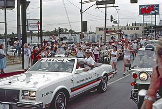 KLAC - In this July 1984 photo, an advertisement poster of KLAC can be seen in the background during the 1984 Summer Olympics torch relay.