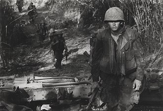 Operation Maine Crag - 2/3 Marines pass a destroyed PAVN truck